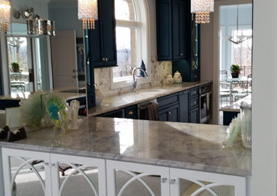 Large Kitchen Island, Granite Countertops & Mirrored Cabinet Doors | Teal & White Contemporary Kitchen
